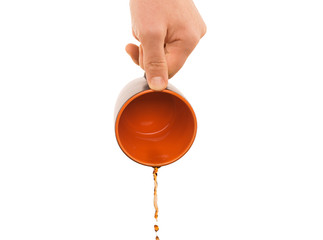 hand with coffee flowing out from mug