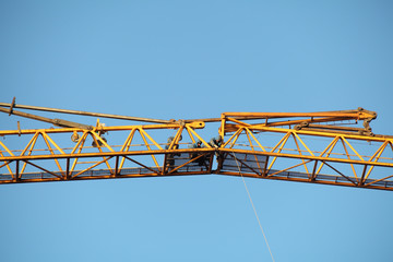 Erection of tower crane, connecting outer jib to inner jib.