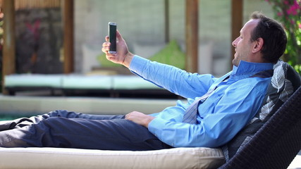 Young businessman taking selfie photo with his cellphone