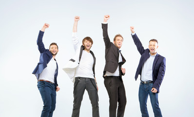 Four guys making a victory gesture