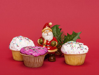Christmas composition with Santa Claus and cupcakes