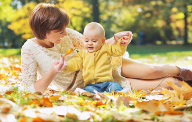 Pretty mom playing with child