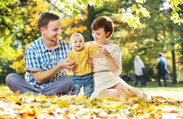 Happy parents with cute baby