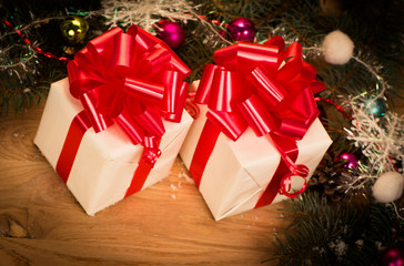 green fir branches on the wooden floor with gifts