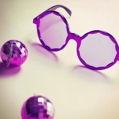Purple sixties glasses with mini disco ball earrings