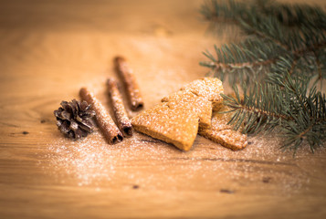Cinnamon Christmas cookies and spices on wooden