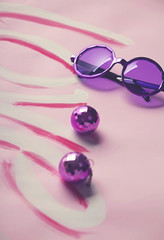 Hippy sixties sunglasses and disco balls on love background
