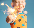 Little boy holding a sparkler