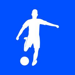 Silhouette of footballer kicking a soccerball