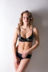 Beautiful model advertises latex lingerie