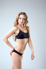 Seductive athletic woman posing in studio