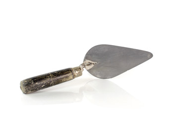 Used trowel, isolated on a white background