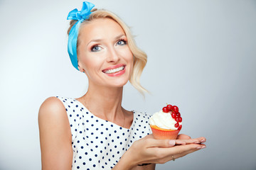 Blonde girl with cake