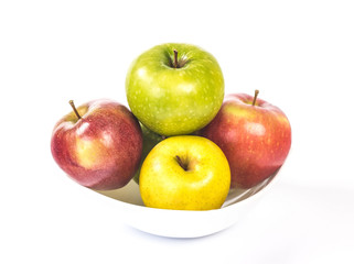 multicolored apples in a white bowl