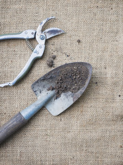 Gardening tools on nature background