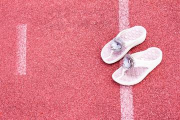 empty stadium arena and sandal shoe on race running track treadm