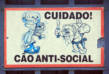 doorplate with warning about angry dog in Curitiba