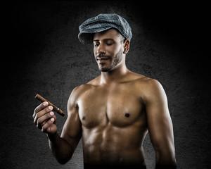 fitness model looking at cigar