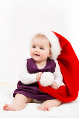 Child girl with Christmas santa hat
