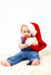 Child girl with Christmas santa hat