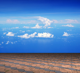 Cement brick floor with cloud and blue sky