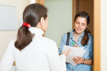 Smiling woman conducting  survey