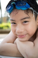 Portrait of happy little boy ready to swimming