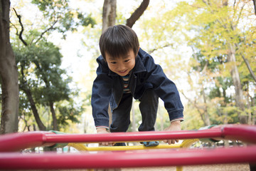Children climbing on playground equipment
