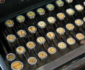 antique typewriter with white keys