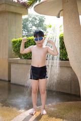 Portrait of happy little boy take a bath before swimming
