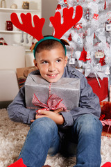 Happy young boy with a Christmas gift
