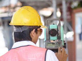 Surveyor engineer making measuring with theodolite instrument eq