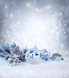 silver balls and decoration on snow - sparkling background