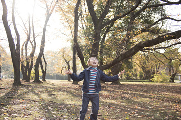 Boy to take a deep breath in the autumn park