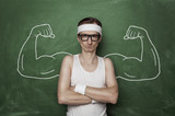 Fototapety Funny sport nerd with fake muscle drawn on the chalkboard