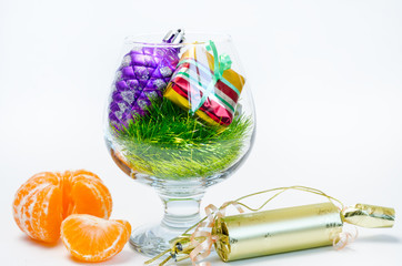 Christmas decorations and tangerines, isolated
