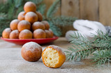 Christmas donuts with powdered sugar with fir branch