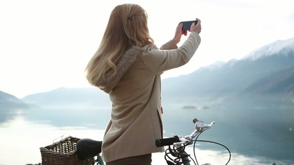 Woman taking a picture using a smartphone
