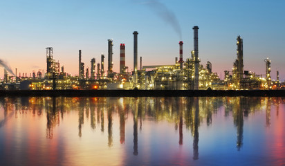 Oil and gas refinery at twilight with reflection - factory - pet