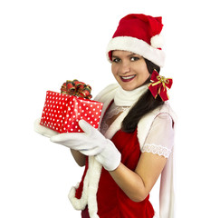 Smiling Santa girl with wrapped gift, isolated on white