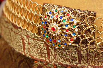 Traditional Thai belt decorated with colorful gemstones