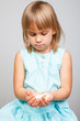 Child holding pills in cupped hands