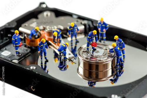 Hard disk repair concept. Macro photo - 73774491