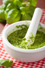 pesto sauce and ingredients over red napkin