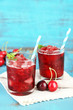 canvas print picture - Closeup of cherry granita in glasses, on color wooden