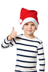 Little Boy in Santa hat with thumbs up sign ok isolated