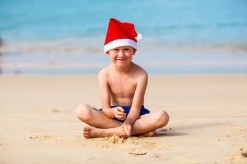 Portrait of cute little boy in Santa hat