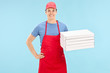 Pizza chef holding a bunch of boxes