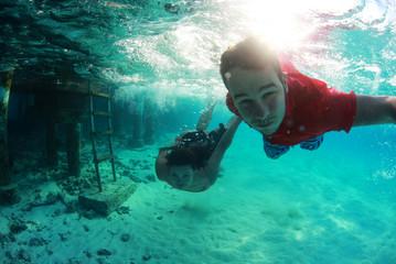 Happy swimmer in the ocean