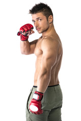 Muscular man with mixed martial arts gloves (MMAs youn